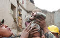 Baby found alive under the rubble