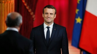 What does Macron believe about laicity?