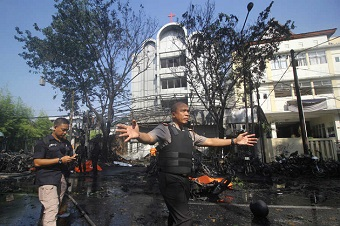 Thirteen killed as Islamist family attacks three churches in Indonesia