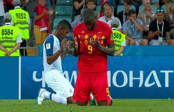 Christian players of Belgium and Panama pray on the pitch after World Cup match