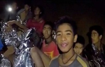 Twelve children and their coach, rescued after 17 days trapped in a cave