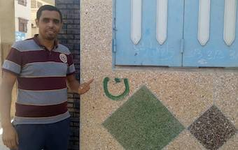 The house of a Moroccan Christian is marked with Arabic letter Nun