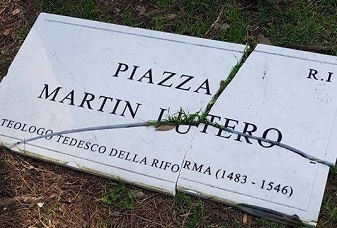 Plaque of the Martin Luther square in Rome shattered