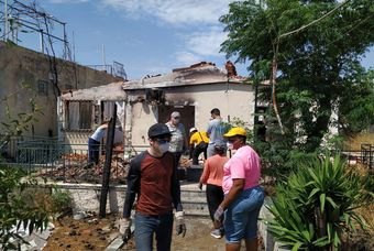 Greek Christians keep helping wildfires victims one year later