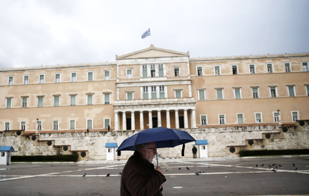 greece parliament man rain