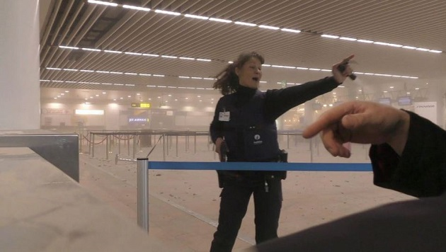 brussels, airport, main hall, police officer,